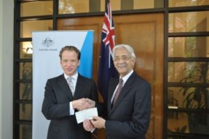 Australian High Commissioner, Mr Greg Wilcock presenting a Cheque of BDT 50,000 to Mr Muhammad Saidur Rahman to support the initiative