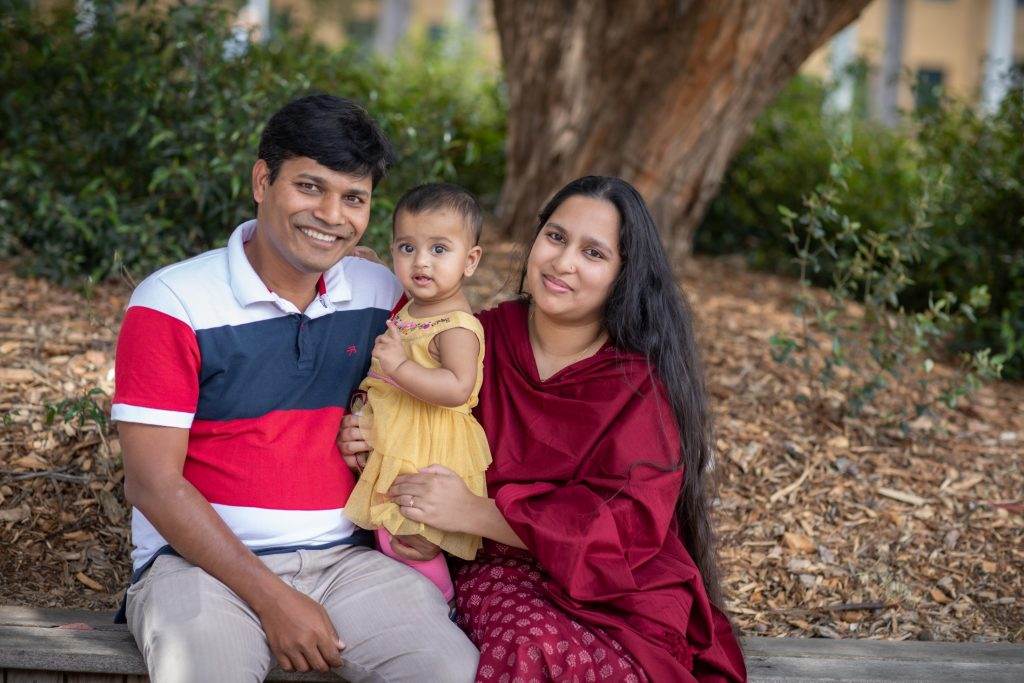 Australia Awards alumnus Hafiz Hassan with his wife and daughter in Australia
